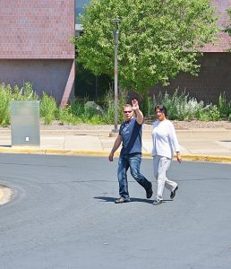 Michael Rhedin and Sandra Grazzini-Rucki leave the courthouse during a break in the trial.