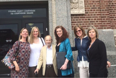Bukstein was pictured (wearing turquoise) with Angela Young (far left), Dale Nathan, and Dede Evavold (far right) outside the Stearns County Courthouse in 2015. Picture source: Facebook.